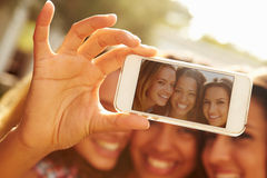 Female Friends On Holiday Taking Selfie With Mobile Phone Royalty Free Stock Photography