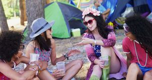 Female friends interacting with each other at music festival 4k. Happy female friends interacting with each other at music festival 4k stock footage