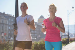 Female friends jogging Royalty Free Stock Photography