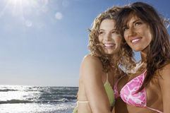 Female Friends Looking Away At Beach Royalty Free Stock Images