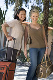 Female Friends With Luggage On Vacation Stock Photos