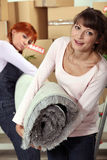Female friends moving house Royalty Free Stock Images