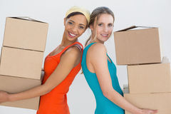 Female friends moving together in a new house Royalty Free Stock Photos