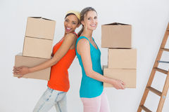 Female friends moving together in a new house Royalty Free Stock Photography