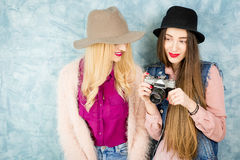 Female friends with photo camera Royalty Free Stock Image