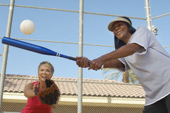 Female Friends Playing Baseball Royalty Free Stock Image