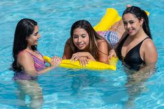 Girls At A Pool Party. Female friends at a pool party in the summer royalty free stock image