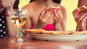 Female friends sharing a pizza Royalty Free Stock Photos