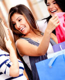 Female friends shopping Stock Images