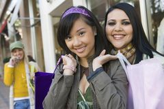 Female Friends With Shopping Bags Royalty Free Stock Photos