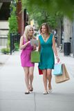 Female Friends With Shopping Bags Using Digital Royalty Free Stock Images