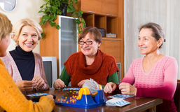 Female friends sitting with lotto Royalty Free Stock Image