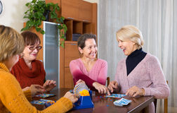 Female friends sitting with lotto Royalty Free Stock Photo