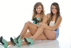 Female friends sitting together Royalty Free Stock Photo
