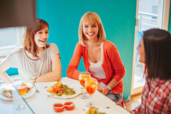Female Friends Socializing At Home Stock Photo