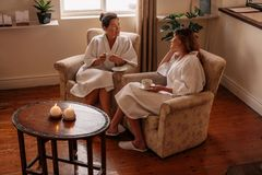 Female friends in spa salon waiting room Stock Image