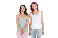Female friends standing over white background Royalty Free Stock Image