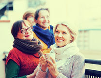Female friends on summer terrace Stock Image