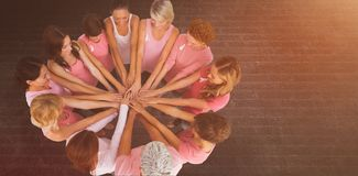 Composite image of female friends supporting breast cancer Royalty Free Stock Photography