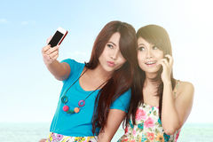 Female friends take picture Stock Photo