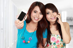 Female friends take picture Royalty Free Stock Photography
