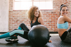 Female friends taking a break from workout in gym Royalty Free Stock Photography