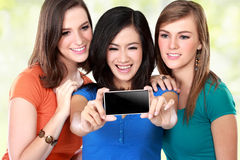 Female friends taking a picture of themselves Stock Photo