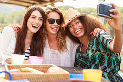 Female Friends Taking Selfie During Lunch Outdoors Stock Photos