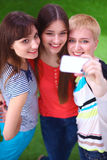 Female friends taking selfie with mobile phone Stock Photography