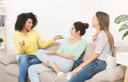 Female friends talking and gossiping at home royalty free stock image