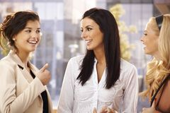 Female friends talking outdoors stock images