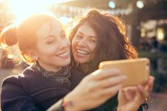 Female friends two women taking selfie during weekend getaway Outdoors. Female friends two women taking selfie having fun during weekend getaway Outdoors Royalty Free Stock Photography