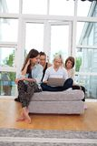 Female friends using laptop Royalty Free Stock Photos