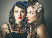 Female friends in vintage clothes with telephone Royalty Free Stock Images