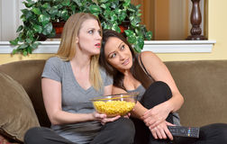 Female friends watching TV Stock Photo