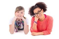 Female friendship - happy teenage girls lying isolated on white Royalty Free Stock Photo