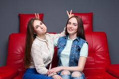 Female friendship, leisure of happy girls Royalty Free Stock Image