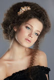 Female with Frizzy Brown Hair and Golden Brooch Royalty Free Stock Photography