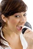 female front microphone singing smiling view Στοκ Εικόνες