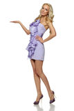 Female in full length in summer dress holding copy space on her palm Royalty Free Stock Photos