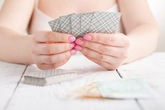Female gamble with play cards Stock Photography