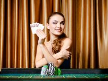 Female gambler with cards at the poker table Royalty Free Stock Photo