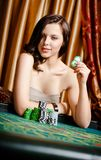 Female gambler at the playing table with chips Royalty Free Stock Photo