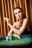 Female gambler at the roulette table Royalty Free Stock Image