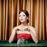 Female gambler sitting at the casino table Royalty Free Stock Photos
