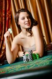 Female gambler at the table with chips Stock Photo
