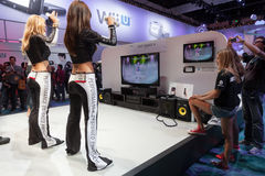 Female gamers with just dance 4 and Nintendo WiiU Royalty Free Stock Photo