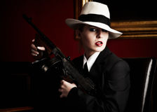 Female gangster. Holding a rifle royalty free stock photo