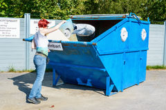 Female at garbage depot Royalty Free Stock Images
