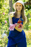 Female gardener in blue uniform Royalty Free Stock Images